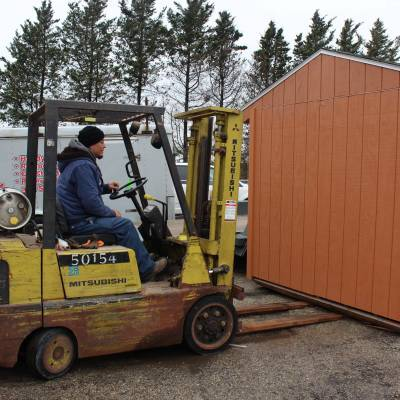 loading up the custom-built shed for client